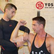 מדידת היקפים בזרוע למתאמן. מתוך פוסט מהיר או איטי - מהו קצב החזרות האידיאלי להיפרטרופיה